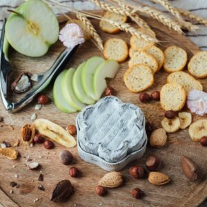 Dorothy's Keep dreaming on a board with crackers, nuts and apple slices