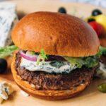 burger with melted saint agur blue cheese