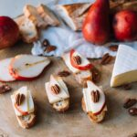 Ile de France brie on a slice of bread with some apple and pecan nut