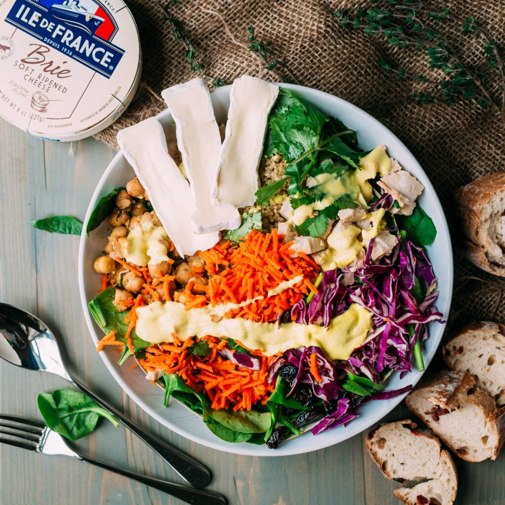colorful salad bowl with vegetables and Ile de france brie