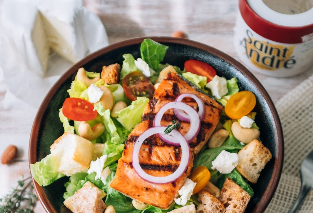 salad bowl with baked salmon and saint andré cheese