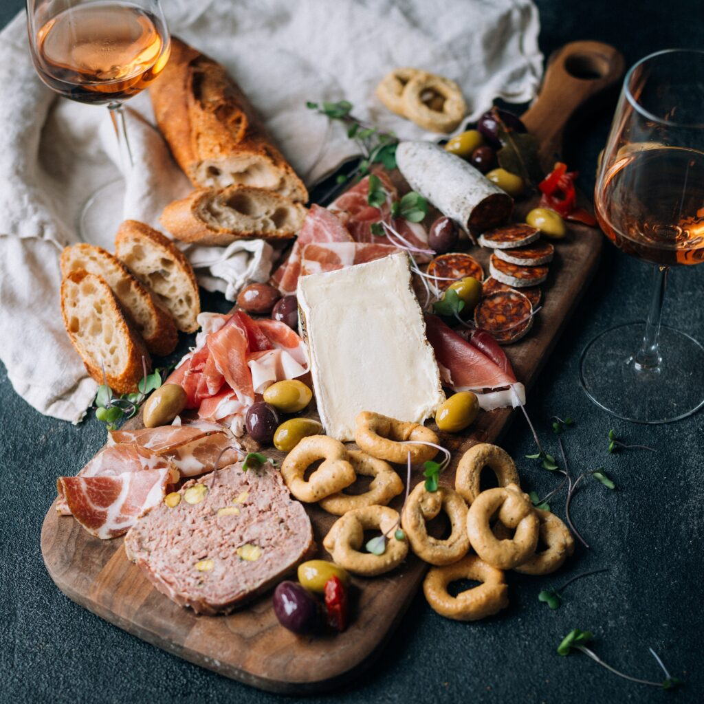 cheese board with saint andré cheese charcuterie and crackers