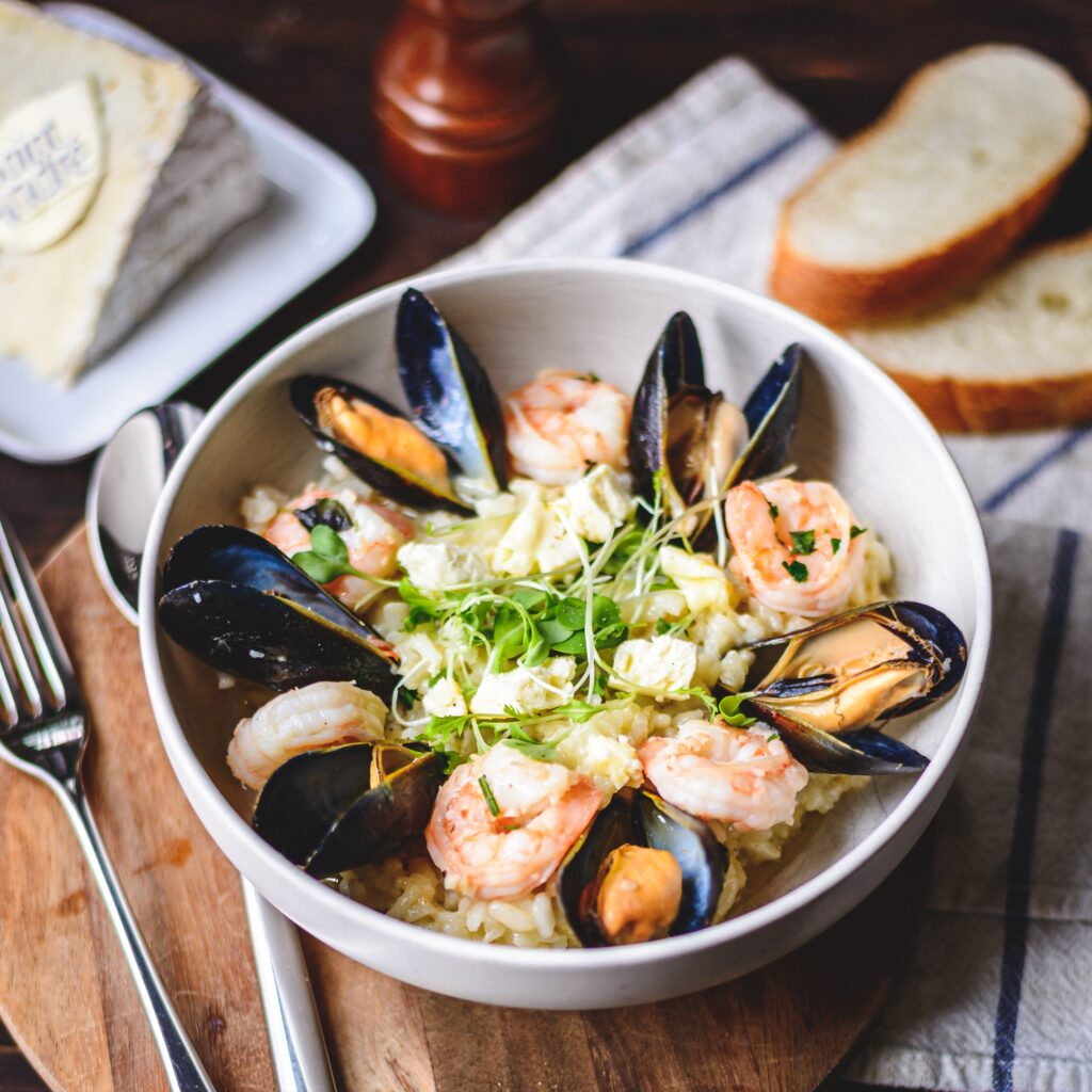 rice bowl with mussels, shrimps and saint andré cheese
